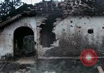 Image of U.S. Army 196th Lt Inf Brigade knock down damaged building wall Vietnam, 1968, second 34 stock footage video 65675021200