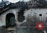 Image of U.S. Army 196th Lt Inf Brigade knock down damaged building wall Vietnam, 1968, second 35 stock footage video 65675021200