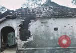Image of U.S. Army 196th Lt Inf Brigade knock down damaged building wall Vietnam, 1968, second 38 stock footage video 65675021200