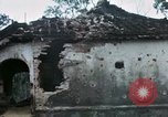 Image of U.S. Army 196th Lt Inf Brigade knock down damaged building wall Vietnam, 1968, second 40 stock footage video 65675021200