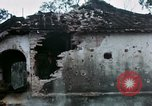Image of U.S. Army 196th Lt Inf Brigade knock down damaged building wall Vietnam, 1968, second 43 stock footage video 65675021200