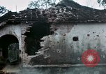 Image of U.S. Army 196th Lt Inf Brigade knock down damaged building wall Vietnam, 1968, second 44 stock footage video 65675021200