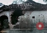 Image of U.S. Army 196th Lt Inf Brigade knock down damaged building wall Vietnam, 1968, second 45 stock footage video 65675021200