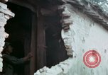 Image of U.S. Army 196th Lt Inf Brigade knock down damaged building wall Vietnam, 1968, second 49 stock footage video 65675021200