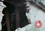 Image of U.S. Army 196th Lt Inf Brigade knock down damaged building wall Vietnam, 1968, second 50 stock footage video 65675021200