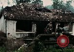 Image of US Army soldiers destroy shelled pagoda building Vietnam, 1968, second 23 stock footage video 65675021204