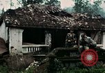 Image of US Army soldiers destroy shelled pagoda building Vietnam, 1968, second 25 stock footage video 65675021204