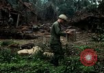 Image of US Army soldiers destroy shelled pagoda building Vietnam, 1968, second 28 stock footage video 65675021204
