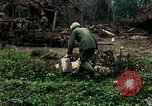 Image of US Army soldiers destroy shelled pagoda building Vietnam, 1968, second 31 stock footage video 65675021204