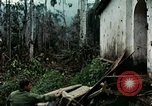 Image of US Army soldiers destroy shelled pagoda building Vietnam, 1968, second 36 stock footage video 65675021204
