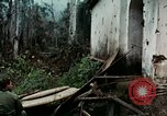 Image of US Army soldiers destroy shelled pagoda building Vietnam, 1968, second 40 stock footage video 65675021204