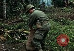 Image of US Army soldiers destroy shelled pagoda building Vietnam, 1968, second 56 stock footage video 65675021204