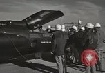 Image of Technicians examine X-15 after landing California United States USA, 1959, second 51 stock footage video 65675021367