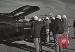 Image of Technicians examine X-15 after landing California United States USA, 1959, second 52 stock footage video 65675021367