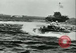 Image of World War II amphibious assault in Pacific Pacific Theater, 1944, second 5 stock footage video 65675021727