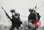 Image of Seargent Collins' team advances United States USA, 1965, second 56 stock footage video 65675022236