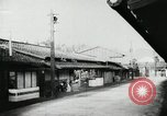 Image of Japanese citizens listen to radio Japan, 1941, second 15 stock footage video 65675022280