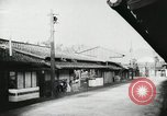 Image of Japanese citizens listen to radio Japan, 1941, second 27 stock footage video 65675022280