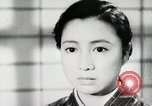 Image of Japanese citizens listen to radio Japan, 1941, second 42 stock footage video 65675022280