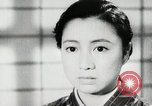 Image of Japanese citizens listen to radio Japan, 1941, second 43 stock footage video 65675022280