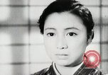 Image of Japanese citizens listen to radio Japan, 1941, second 44 stock footage video 65675022280