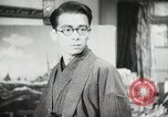 Image of Japanese citizens listen to radio Japan, 1941, second 48 stock footage video 65675022280