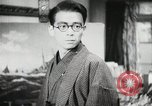 Image of Japanese citizens listen to radio Japan, 1941, second 49 stock footage video 65675022280