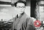 Image of Japanese citizens listen to radio Japan, 1941, second 50 stock footage video 65675022280
