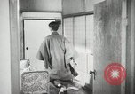 Image of Japanese citizens listen to radio Japan, 1941, second 54 stock footage video 65675022280