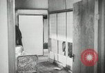 Image of Japanese citizens listen to radio Japan, 1941, second 55 stock footage video 65675022280