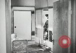 Image of Japanese citizens listen to radio Japan, 1941, second 56 stock footage video 65675022280