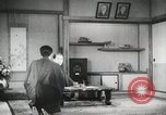 Image of Japanese citizens listen to radio Japan, 1941, second 61 stock footage video 65675022280
