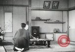 Image of Japanese citizens listen to radio Japan, 1941, second 62 stock footage video 65675022280
