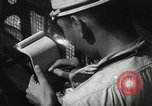 Image of Officers on Japanese submarine plot position and navigate Indian Ocean, 1942, second 32 stock footage video 65675022283