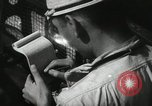 Image of Officers on Japanese submarine plot position and navigate Indian Ocean, 1942, second 33 stock footage video 65675022283