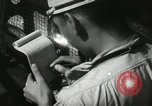 Image of Officers on Japanese submarine plot position and navigate Indian Ocean, 1942, second 34 stock footage video 65675022283