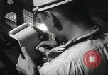 Image of Officers on Japanese submarine plot position and navigate Indian Ocean, 1942, second 35 stock footage video 65675022283