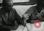 Image of Officers on Japanese submarine plot position and navigate Indian Ocean, 1942, second 59 stock footage video 65675022283