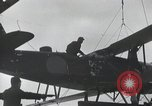 Image of Biplane on Japanese ship Japan, 1940, second 18 stock footage video 65675022298