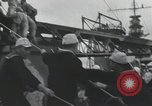 Image of Biplane on Japanese ship Japan, 1940, second 22 stock footage video 65675022298