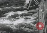 Image of Japanese battleship and other warships getting underway Japan, 1941, second 32 stock footage video 65675022302