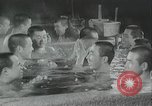 Image of Japanese sailors completing training in World War 2 Japan, 1942, second 50 stock footage video 65675022309