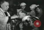 Image of priest performs religious ceremony United States USA, 1934, second 59 stock footage video 65675022430