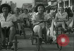 Image of mechanical hobby-horse race Santa Monica California USA, 1934, second 15 stock footage video 65675022442