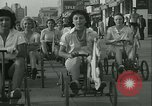 Image of mechanical hobby-horse race Santa Monica California USA, 1934, second 17 stock footage video 65675022442