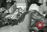 Image of mechanical hobby-horse race Santa Monica California USA, 1934, second 32 stock footage video 65675022442