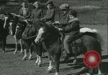 Image of Young children riding horses Kansas City Missouri USA, 1934, second 21 stock footage video 65675022443