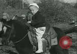 Image of Young children riding horses Kansas City Missouri USA, 1934, second 23 stock footage video 65675022443