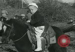 Image of Young children riding horses Kansas City Missouri USA, 1934, second 24 stock footage video 65675022443