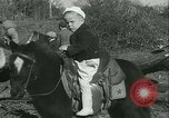 Image of Young children riding horses Kansas City Missouri USA, 1934, second 25 stock footage video 65675022443
